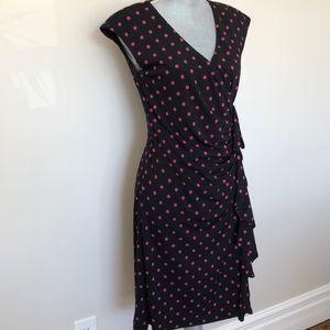 Black with pink polka dots wrap dress.